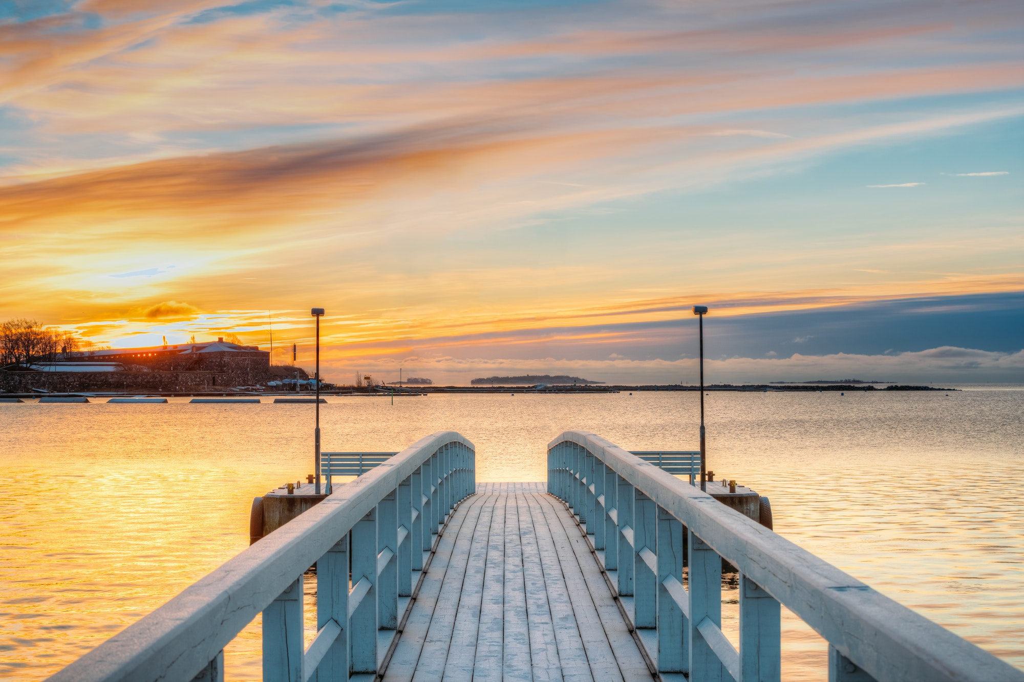 Old Frosted Wooden Boards Pier On Calm Water Of Lake Or River Or
