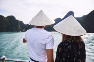 Rear view of couple in hats during the cruise