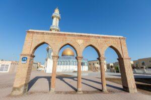 Bani Hashem mosque in Abu Dhabi seen through the gates. Ramadan Kareem, Ramadan Mubarak!